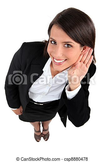 Businesswoman with hand to ear - csp8880478