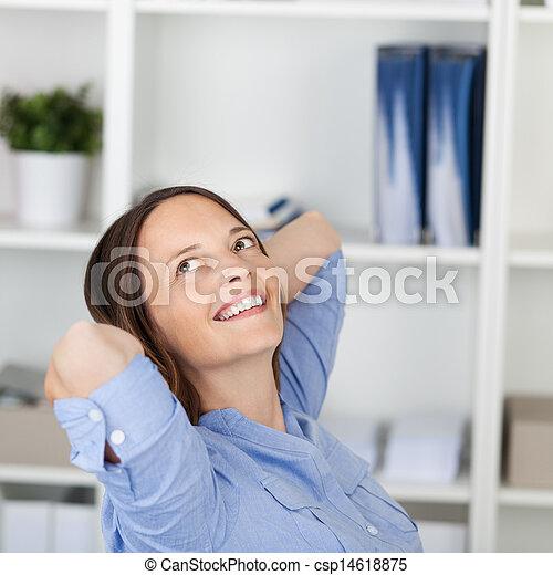 Businesswoman With Hands Behind Head Looking Away - csp14618875