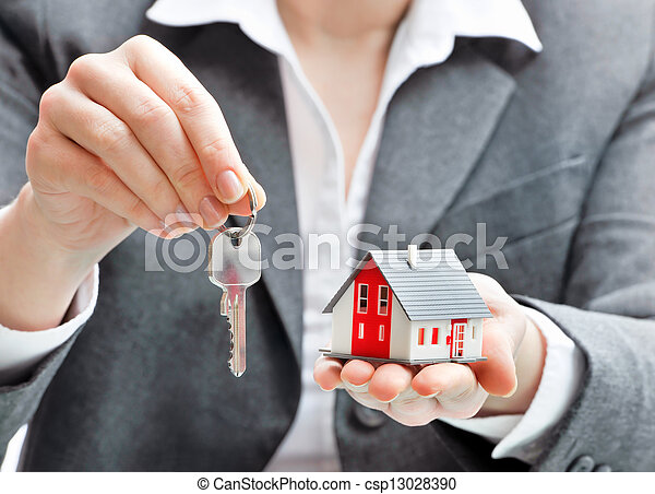 Businesswoman with house model and keys - csp13028390