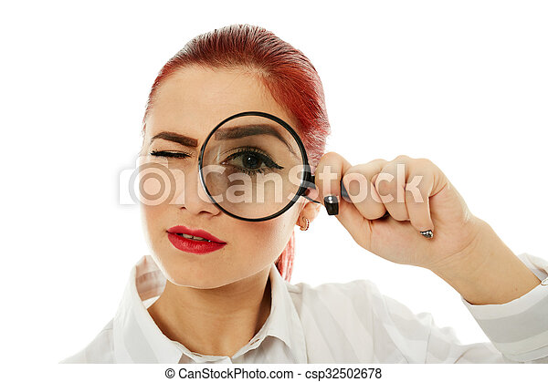 Businesswoman with magnifying glass - csp32502678