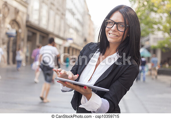 Businesswoman With Tablet Computer on street - csp10359715