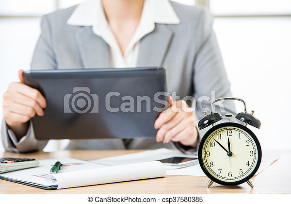 Businesswoman with tablet PC in the stock market timing - csp37580385