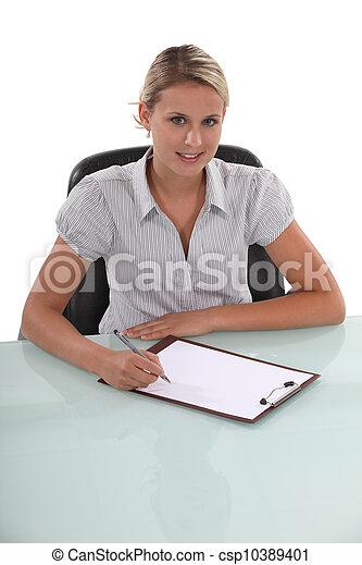 businesswoman working at her desk - csp10389401