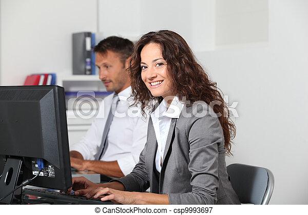 Businesswoman working on computer - csp9993697