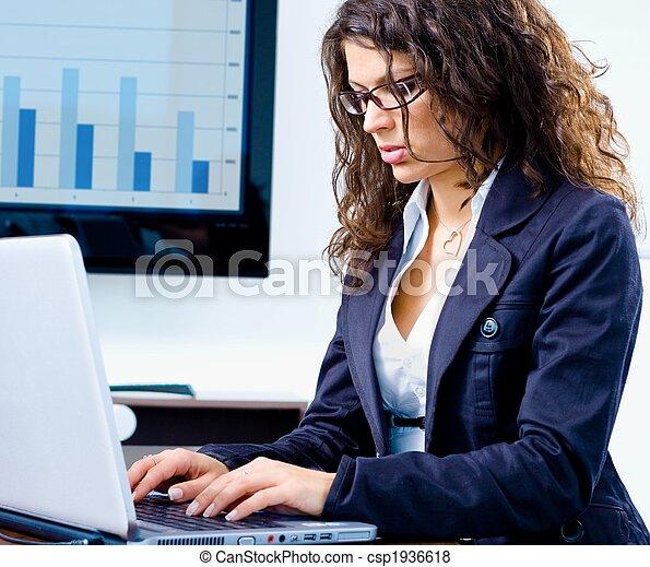Businesswoman working on computer - csp1936618