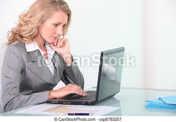 Businesswoman working on laptop - csp8783257