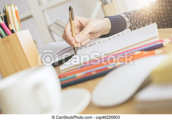 Businesswoman writing in notepad - csp46226803