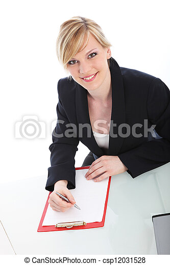 Businesswoman writing on a clipboard - csp12031528