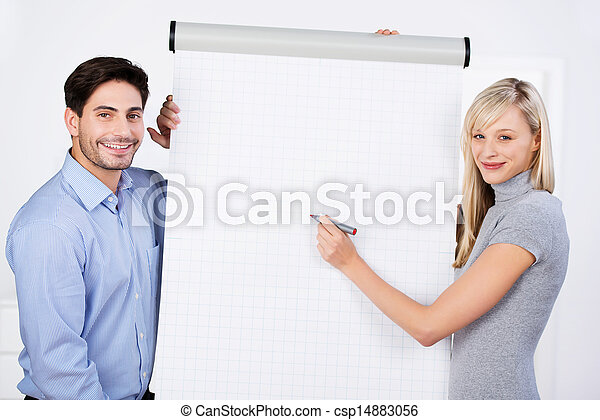 Businesswoman Writing On Flipchart - csp14883056