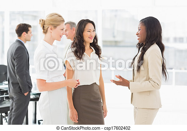 Businesswomen speaking together in conference room - csp17602402