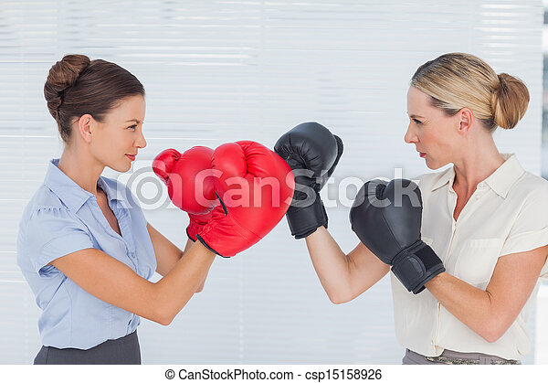 Businesswomen with boxing gloves fighting - csp15158926