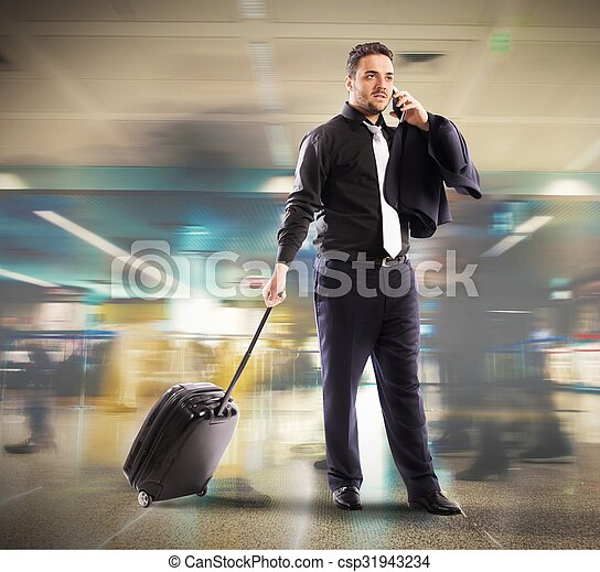 Busy businessman in airport - csp31943234