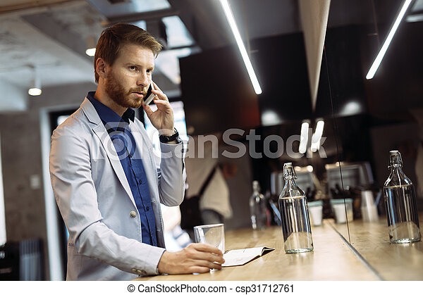Busy businessman talking on phone - csp31712761