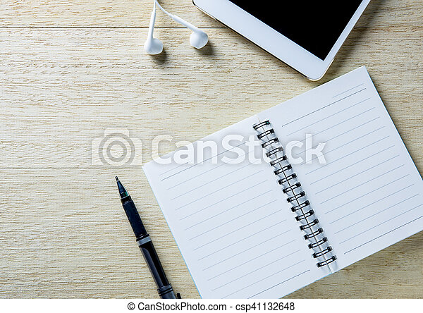 Busy desk of a businessman with an open diary and tablet. - csp41132648