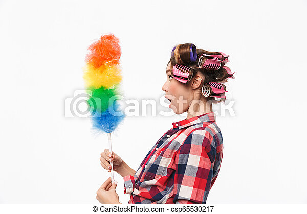 Busy housewife with curlers in hair standing isolated over ...