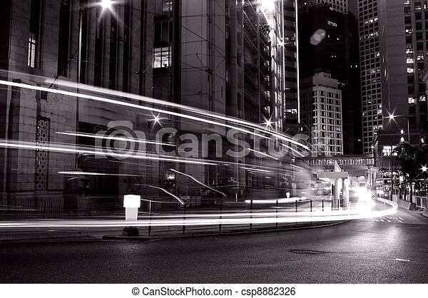 Busy traffic in Hong Kong at night in black and white  - csp8882326