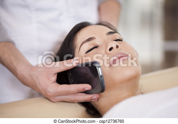 Busy young woman at a spa - csp12736760