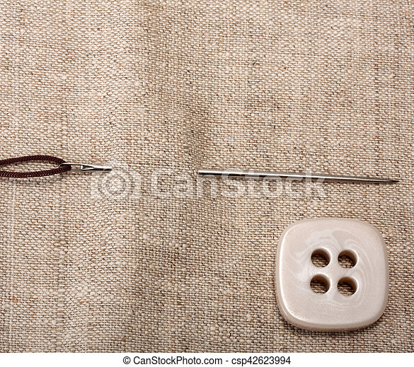 button, thread with a needle - csp42623994