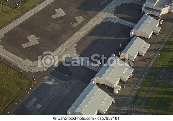 C-17 Tail Sticking Out of Hangar at Air Force Base - csp7957181