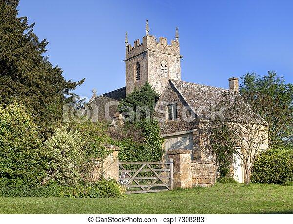 Iglesia y cabaña Cotswold - csp17308283