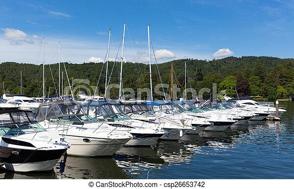 Cabin cruiser boats row on lake  - csp26653742