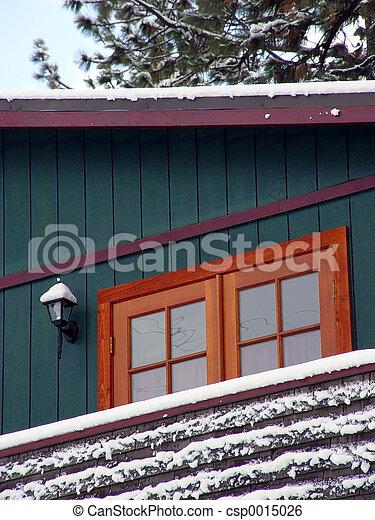 Cabin in snow woods - csp0015026