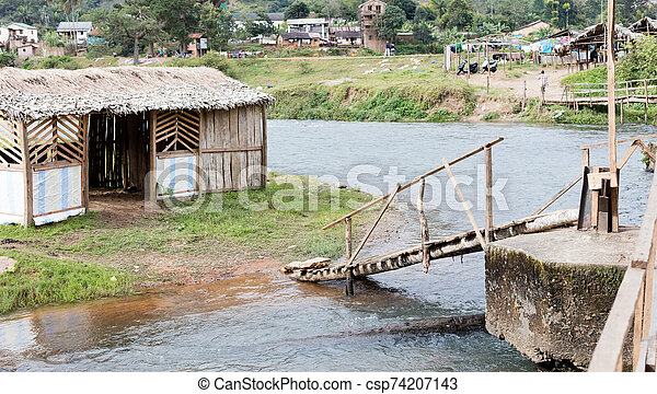 Cabin in the middle of a river - csp74207143