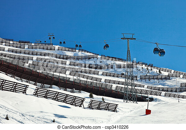 Cable car ski lift over a mountain slope in operation. - csp3410226