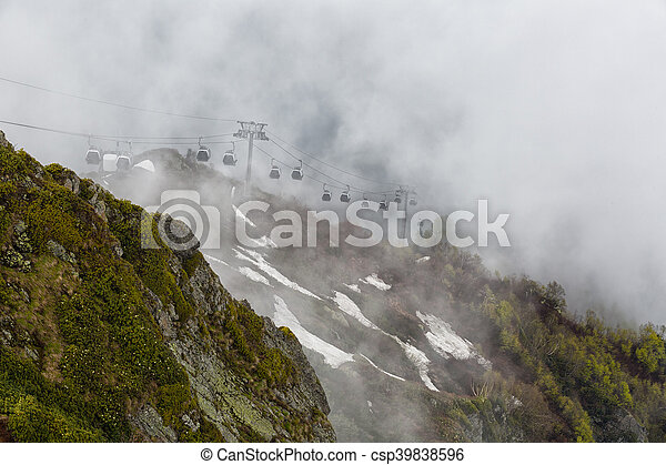 Cableway Gondola in the mountains on a cloudy summer day - csp39838596