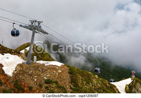 Cableway Gondola in the mountains on a cloudy summer day - csp41206097