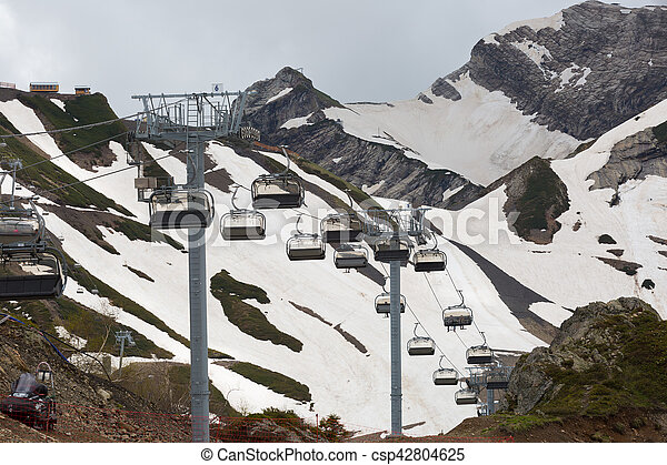 Cableway in mountains on a cloudy summer day - csp42804625