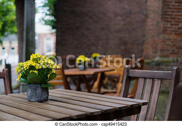 Cafe chairs outside in a street - csp49415423