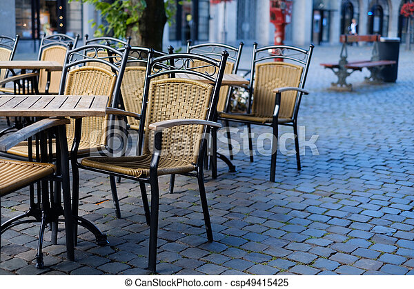 Cafe chairs outside in a street - csp49415425