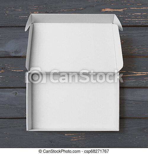 Abre una caja blanca de cartón con vista de madera pintada negra - csp68271767