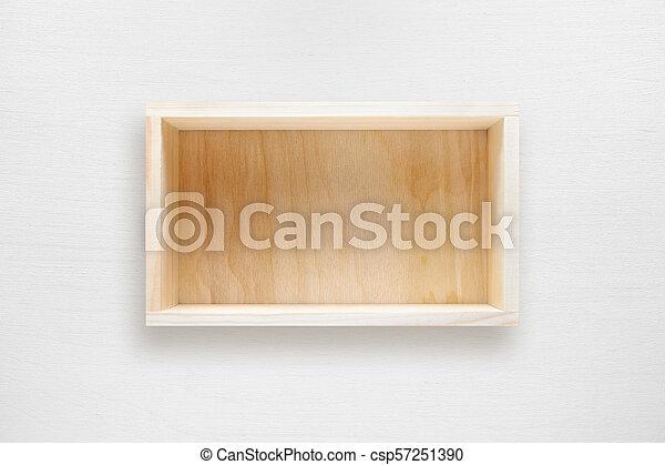 Caja de madera en la mesa blanca de la vista superior - csp57251390
