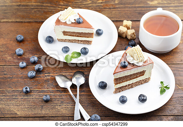 cake with tea on the table - csp54347299