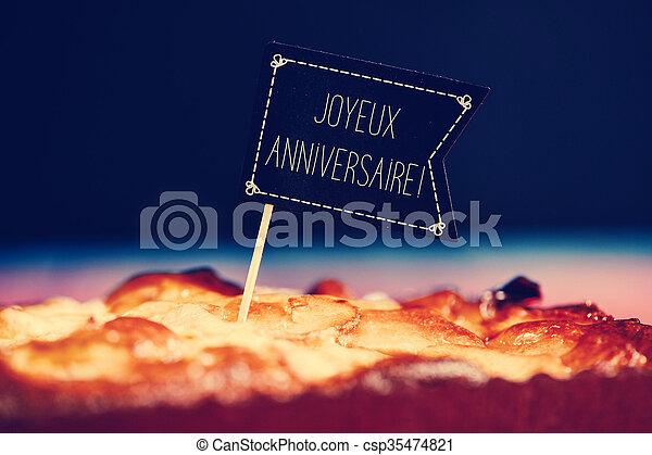 Happy Birthday Feliz Cumpleaños Bon Anniversaire ~ Cake with text joyeux anniversaire happy birthday in stock photo