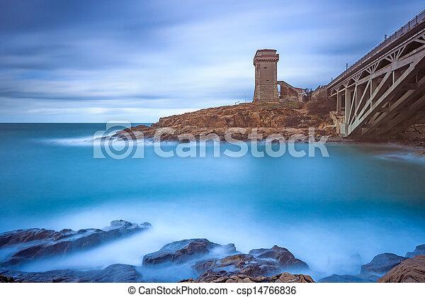 Calafuria Tower landmark on cliff rock, aurelia bridge and sea. Tuscany, Italy. Long exposure photography. - csp14766836