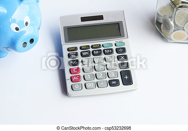 Calculator and blue piggy bank and bottle saving coins on white backgrounds - csp53232698