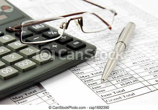 Calculator and glasses on financial report - csp1692390