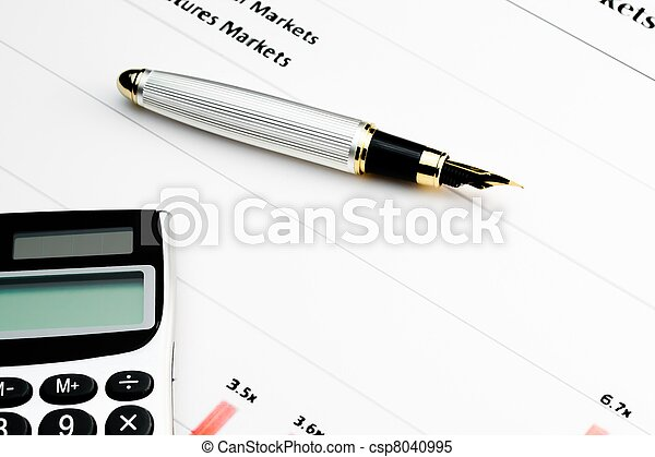 calculator and pen on financial chart - csp8040995