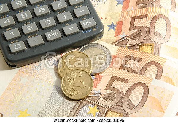 Calculator on a fifty euros - csp23582896