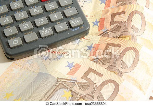 Calculator on a fifty euros - csp23558804