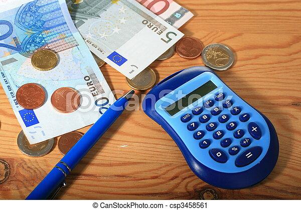 Calculator, pen and money. - csp3458561