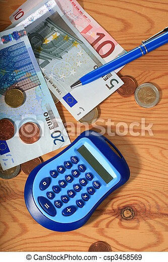 Calculator, pen and money. - csp3458569