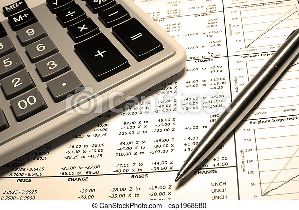 Calculator, steel pen and financial data with graphs. - csp1968580