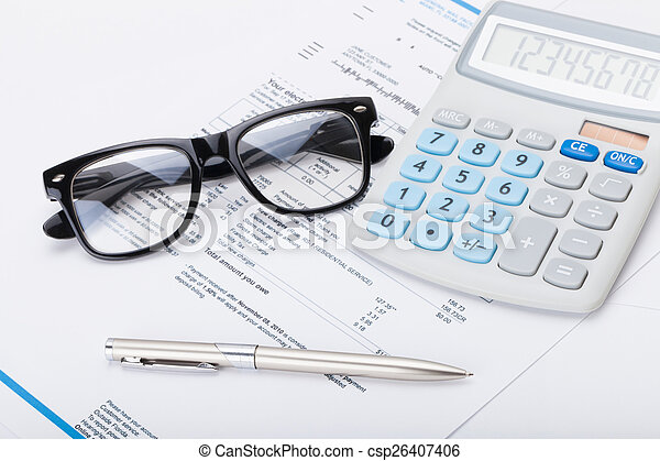 Calculator with pen, glasses and utility bill under it - csp26407406