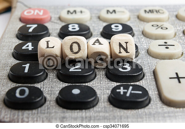 Calculator with the word loan written in wooden block letters - csp34071695