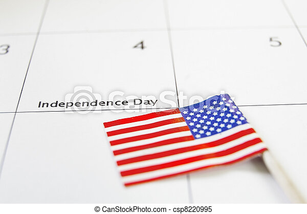 Calendar on the 4th of July and an American flag - csp8220995