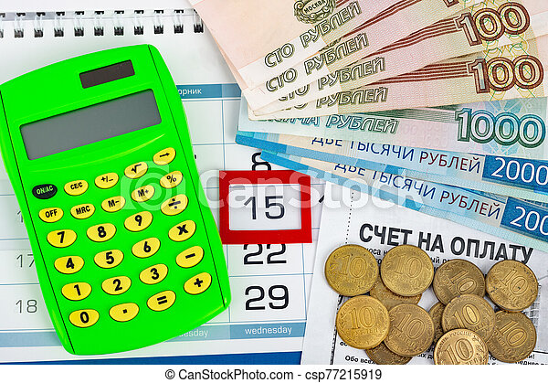 Calendar with a dedicated 15 number, calculator, Russian rubles banknotes and coins - csp77215919